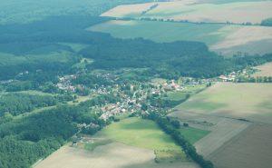 `Luftbild Menz` aus Bildarchiv Flütsch
